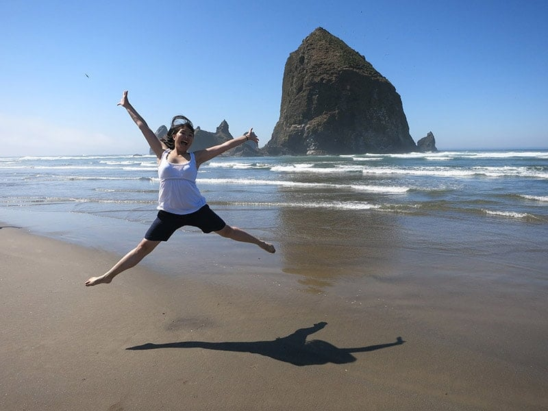 Adelina jumping for joy at Cannon Beach Oregon